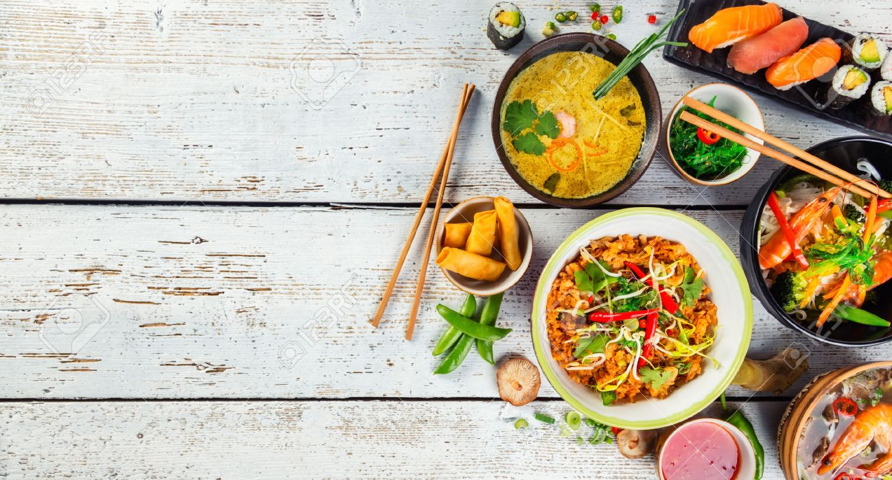 Asian food served on white wooden table, top view, space for text. Chinese and vietnamese cuisine set. - 72245557