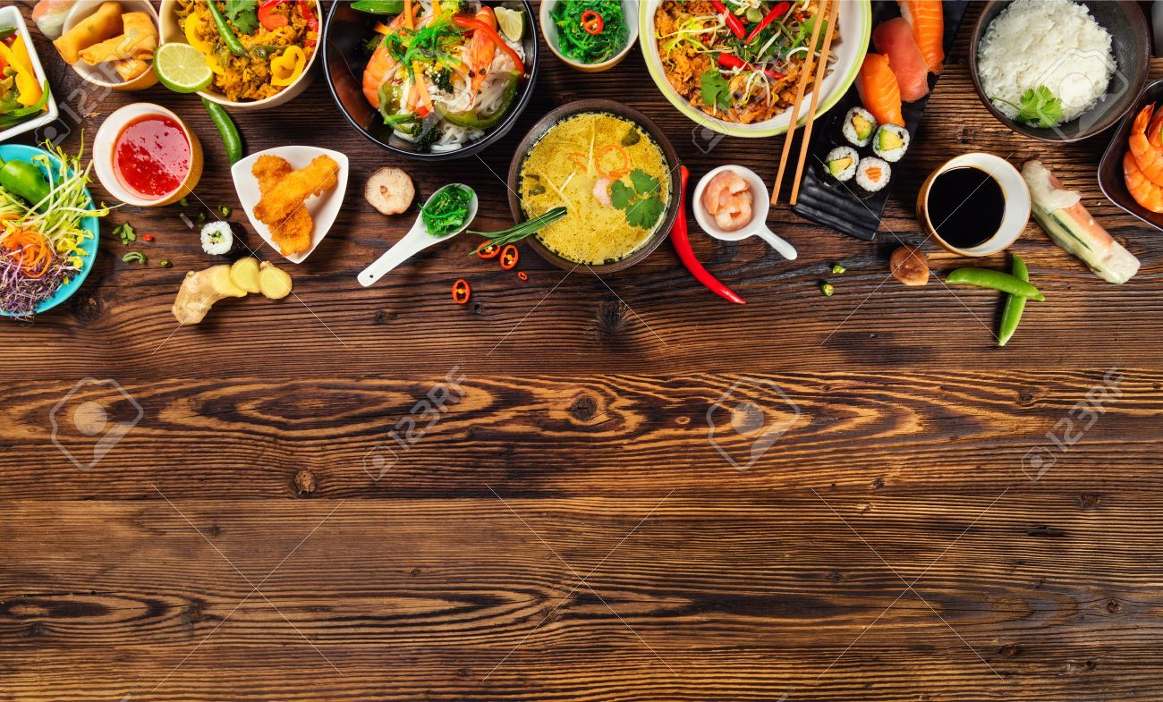 Asian food served on old wooden table, top view, space for text. Chinese and vietnamese cuisine set. - 72504515