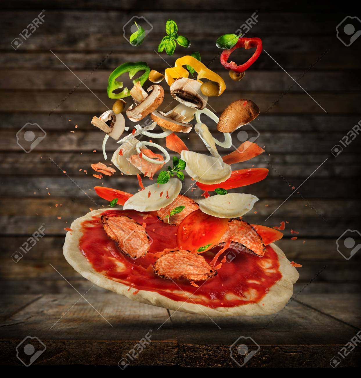Concept of flying ingredients with pizza dough, placed on wooden planks background. Food preparation, fresh meal ready for cooking - 75205871