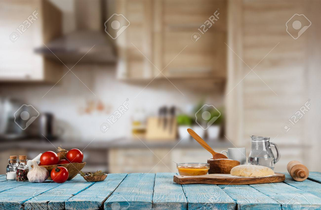 Baking ingredients placed on wooden table, ready for cooking. Copyspace for text. Concept of food preparation, kitchen on background. - 75482232