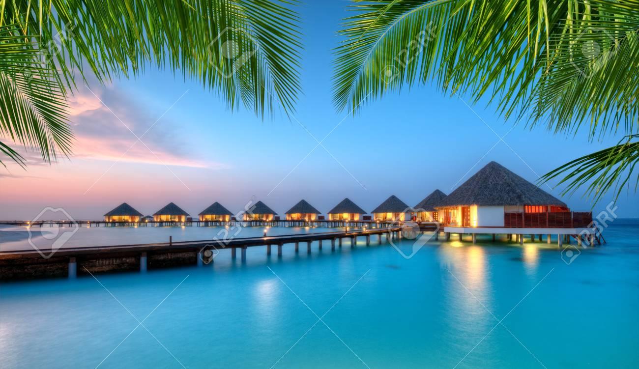 Water Villas In Lagon Maldives Resort Island In Sunset Detail