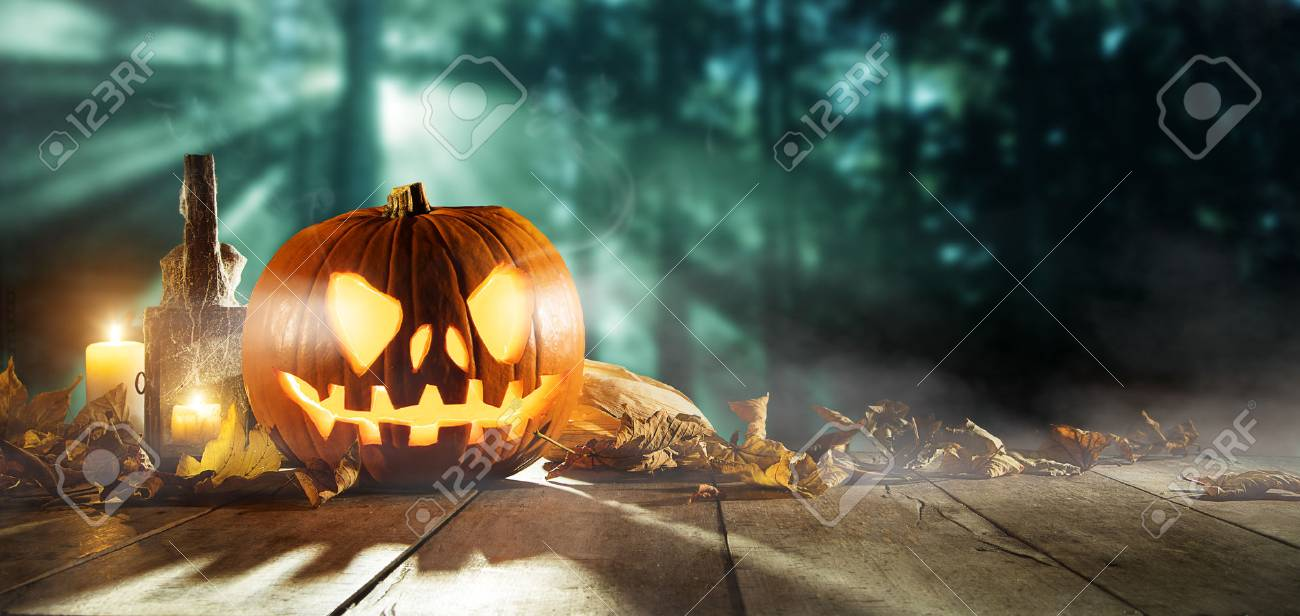Spooky halloween pumpkins on wooden planks with dark horror background. Celebration theme, copyspace for text. - 86502027
