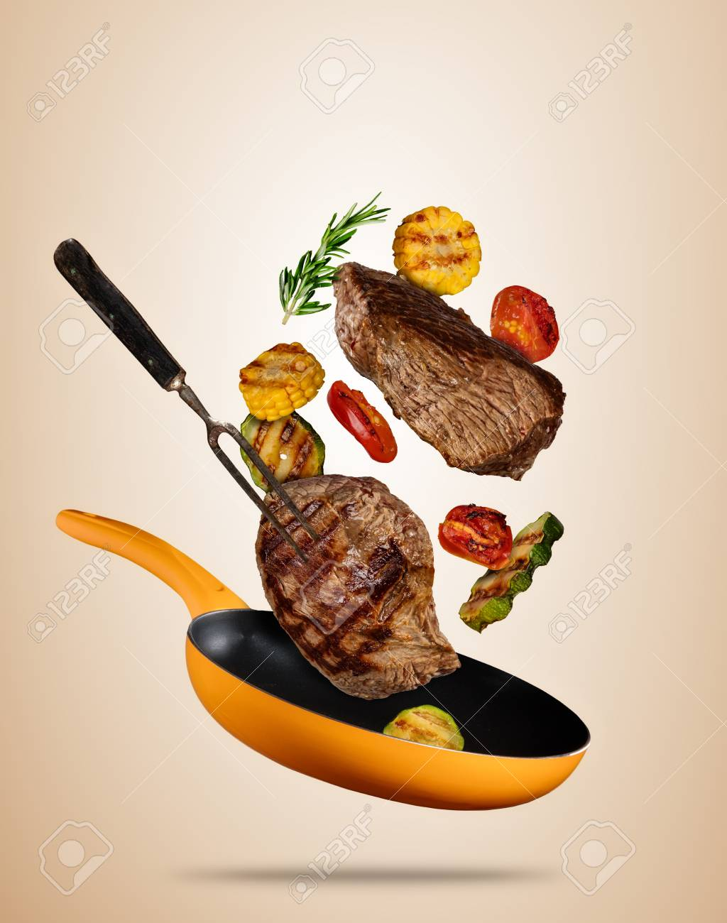 Flying Beef Steaks With Grilled Vegetable On Pan Concept Of Stock