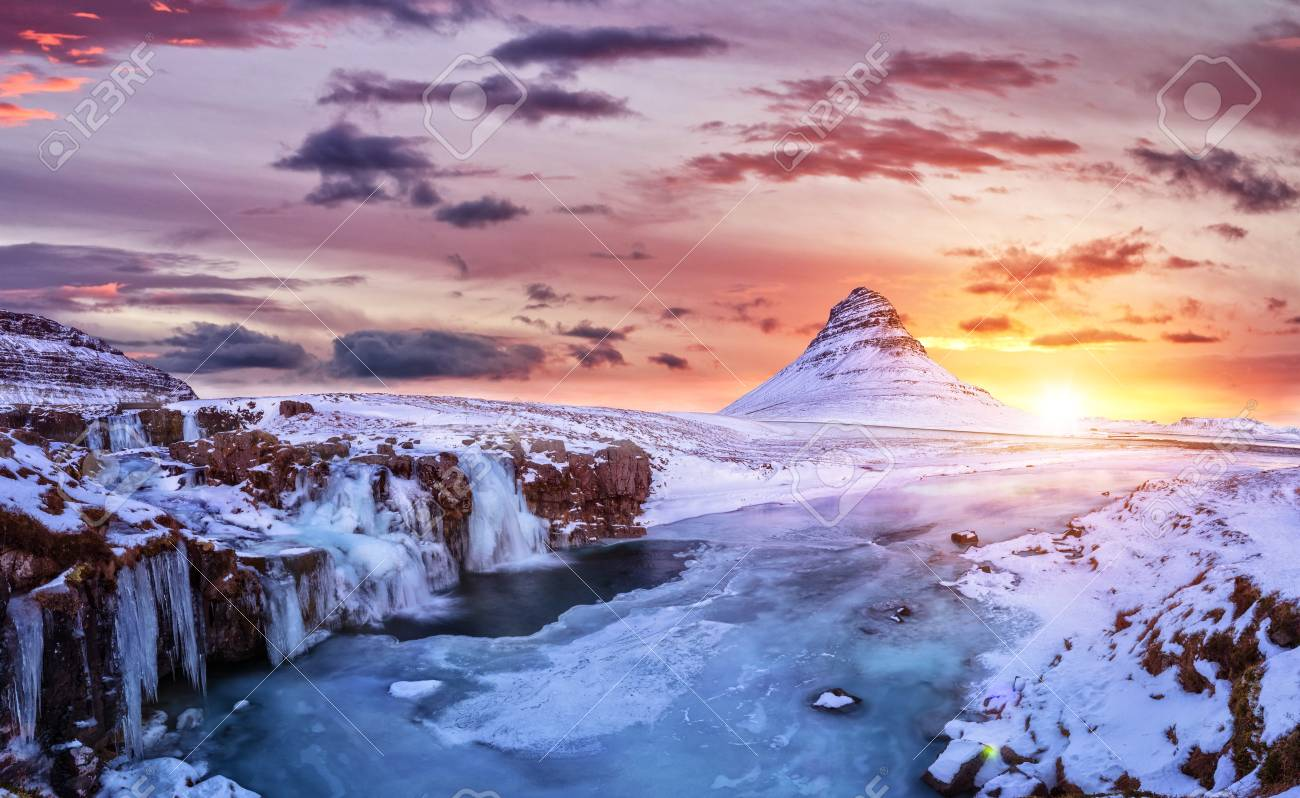 Kirkjufell mountain with frozen water falls in winter, Iceland. One of the famous natural heritage in Iceland. - 91913429