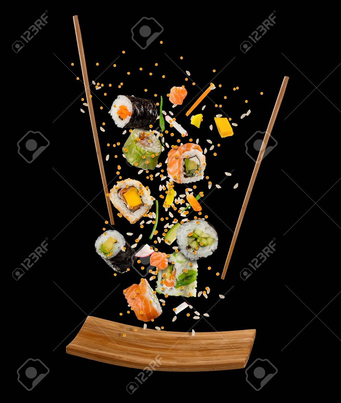 Flying pieces of sushi with wooden chopsticks and plate, isolated on black background. Flying food and motion concept. Very high resolution image - 93386829