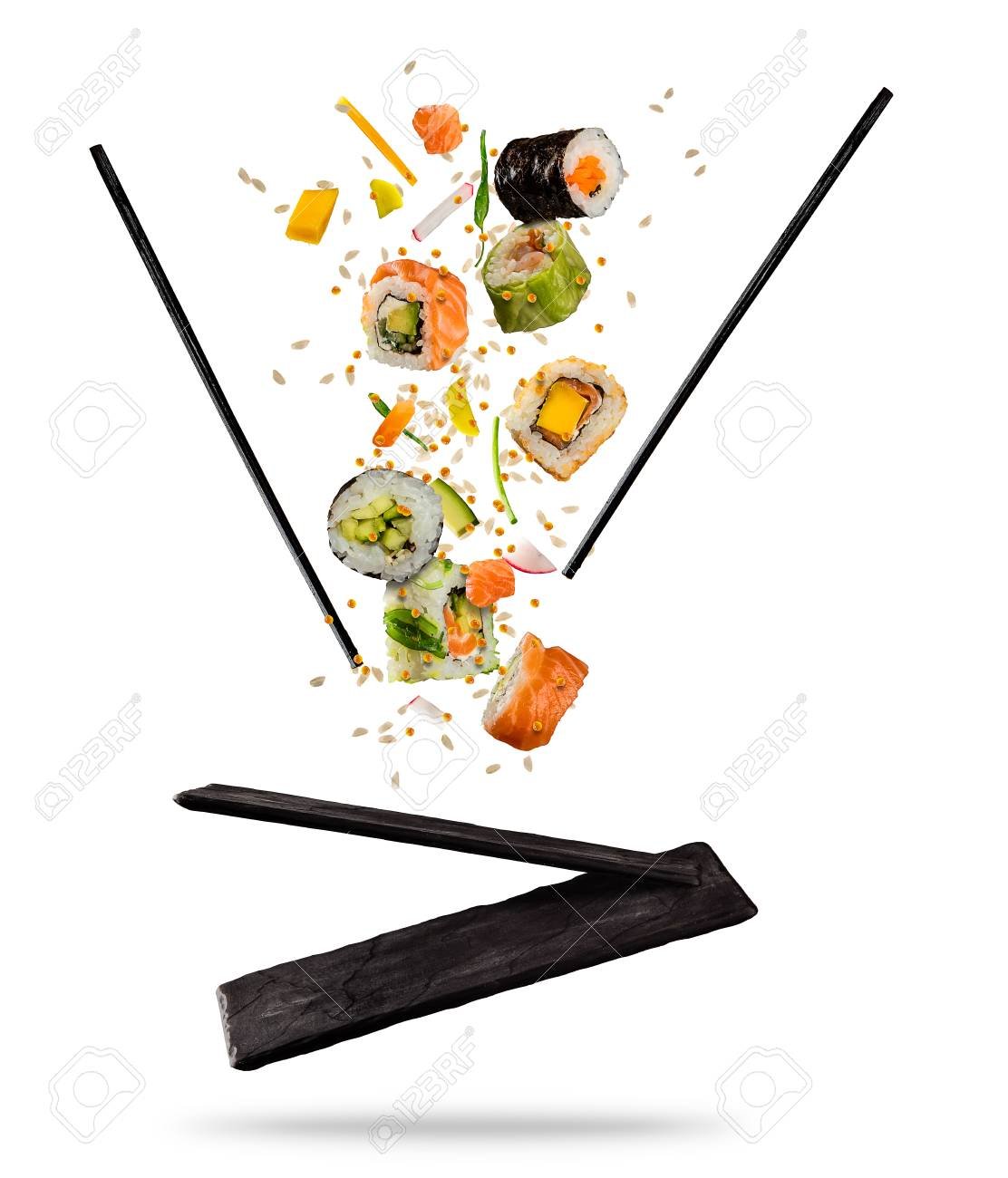 Flying pieces of sushi with wooden chopsticks and stone plate, isolated on white background. Flying food and motion concept. Very high resolution image - 93386830
