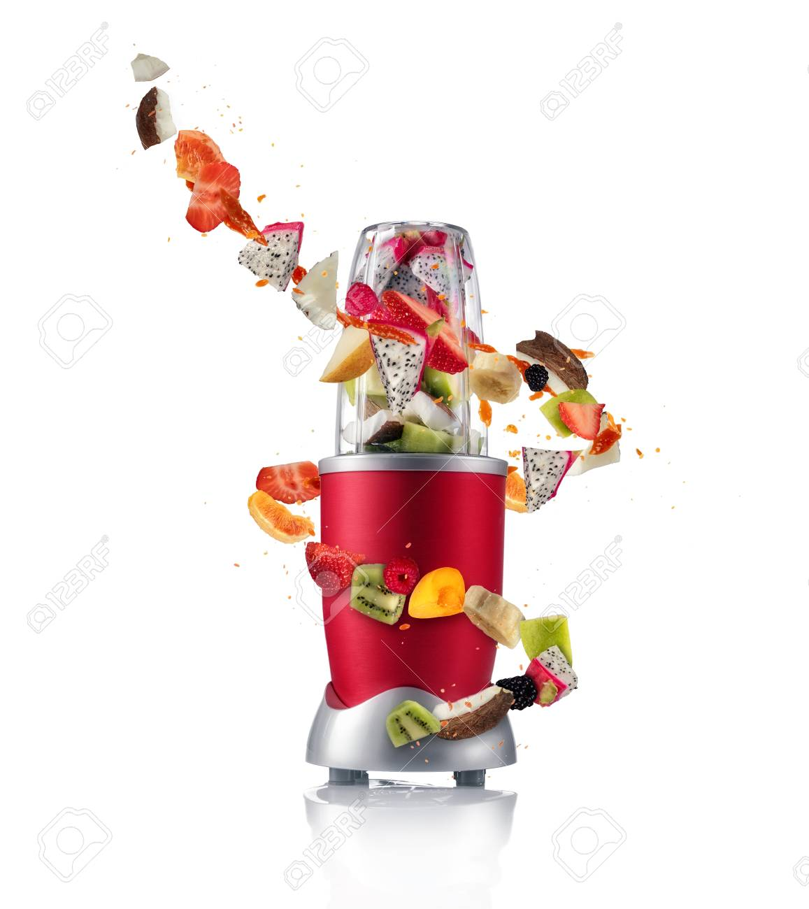 Smoothie maker mixer with pieces of fruit ingredients, isolated on white background. Healthy drink and lifestyle - 97362753