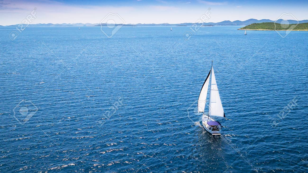 Sailing boat on open water, aerial view. Active life style, water transportation and marine sport. - 104245172