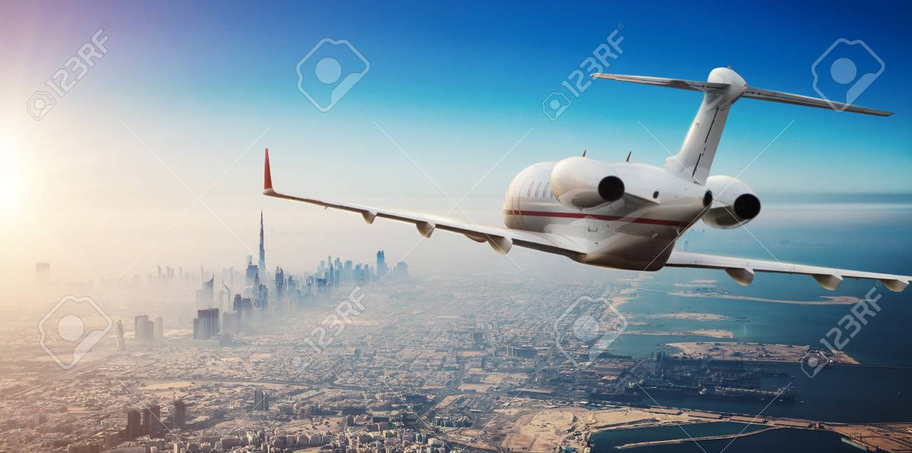 Luxury private jetliner flying above Dubai city, UAE. Modern and fastest mode of transportation, symbol of luxury and business traveling. - 107412543