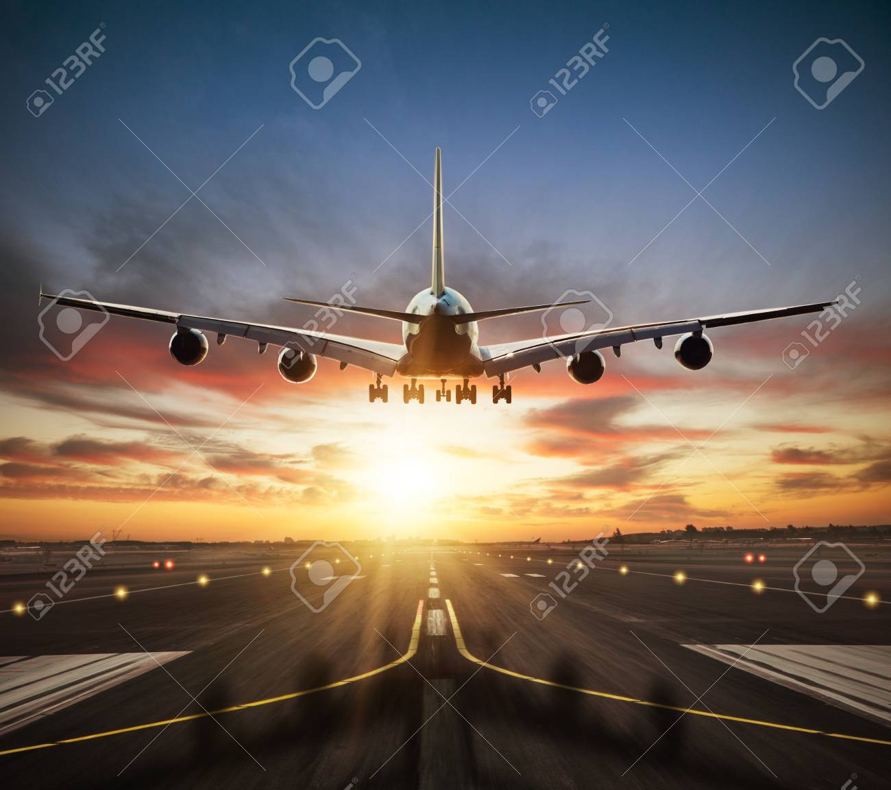 Huge two storeys commercial jetliner taking of runway. Modern and fastest mode of transportation. Dramatic sunset sky on background - 107412509