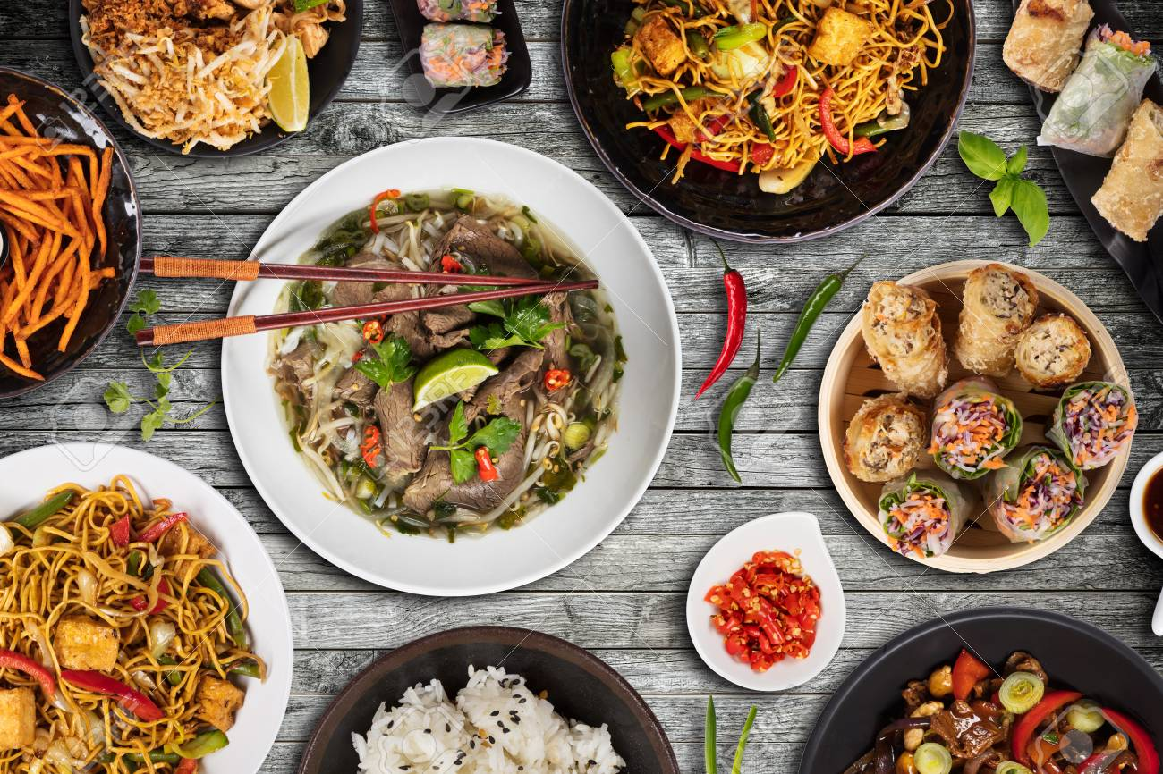 Top view composition of various Asian food in bowls served on wooden table - 121033702