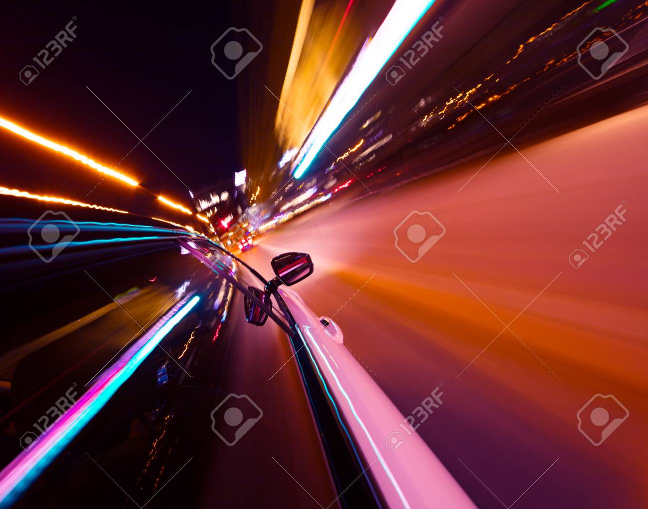 POV of car driving at night city with motion blur effect. Transportation and traffic concept - 121593787
