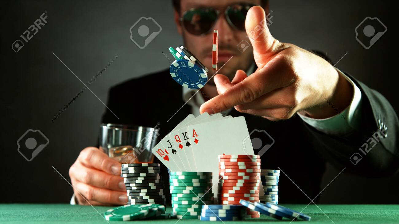 Poker player throwing chips. Concept of hazard gaming, poker chips on table - 147368726