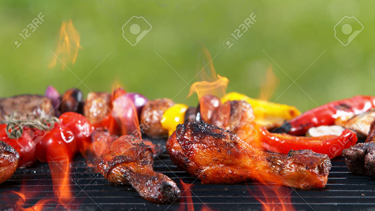 Assorted delicious grilled fish meat with vegetables. Outdoor grill barbecue mix. - 168969311