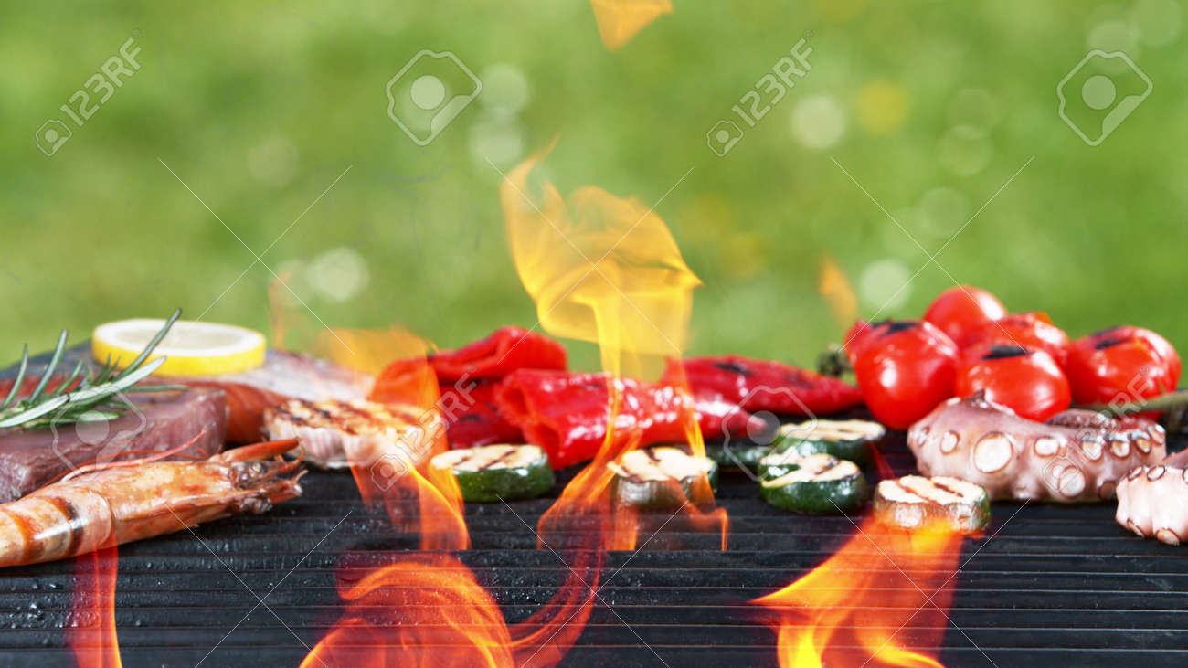 Assorted delicious grilled fish meat with vegetables. Outdoor grill barbecue mix. - 168969615