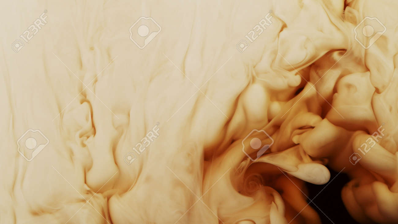 Detail of coffee drink being pour into foamy coffee drink. Abstract coffee background. - 168969838
