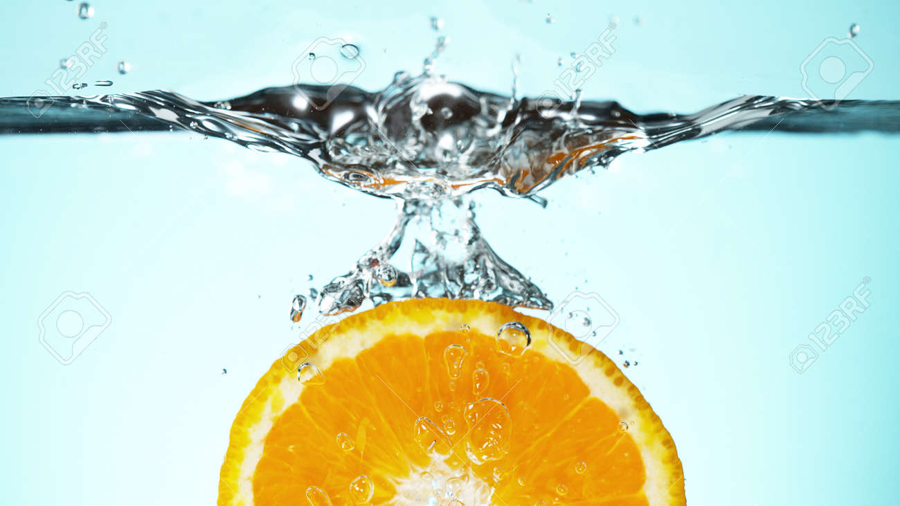 Fresh lime dropped into water with splash and ice cubes. Studio shot with clear background. - 170440473