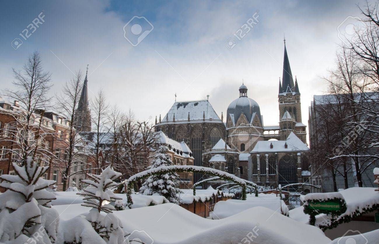 Snow covered Aachen during winter - 8710816