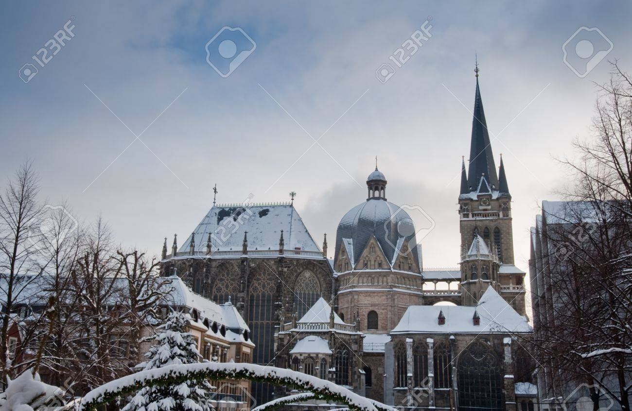 Snow covered Aachen during winter - 8710796