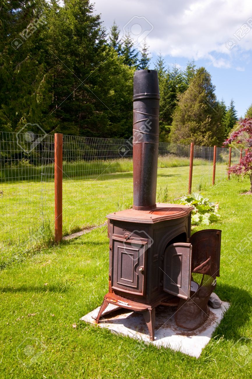 Stock Photo - Wood burning stove outside - Wood Burning Stove Outside Stock Photo, Picture And Royalty Free