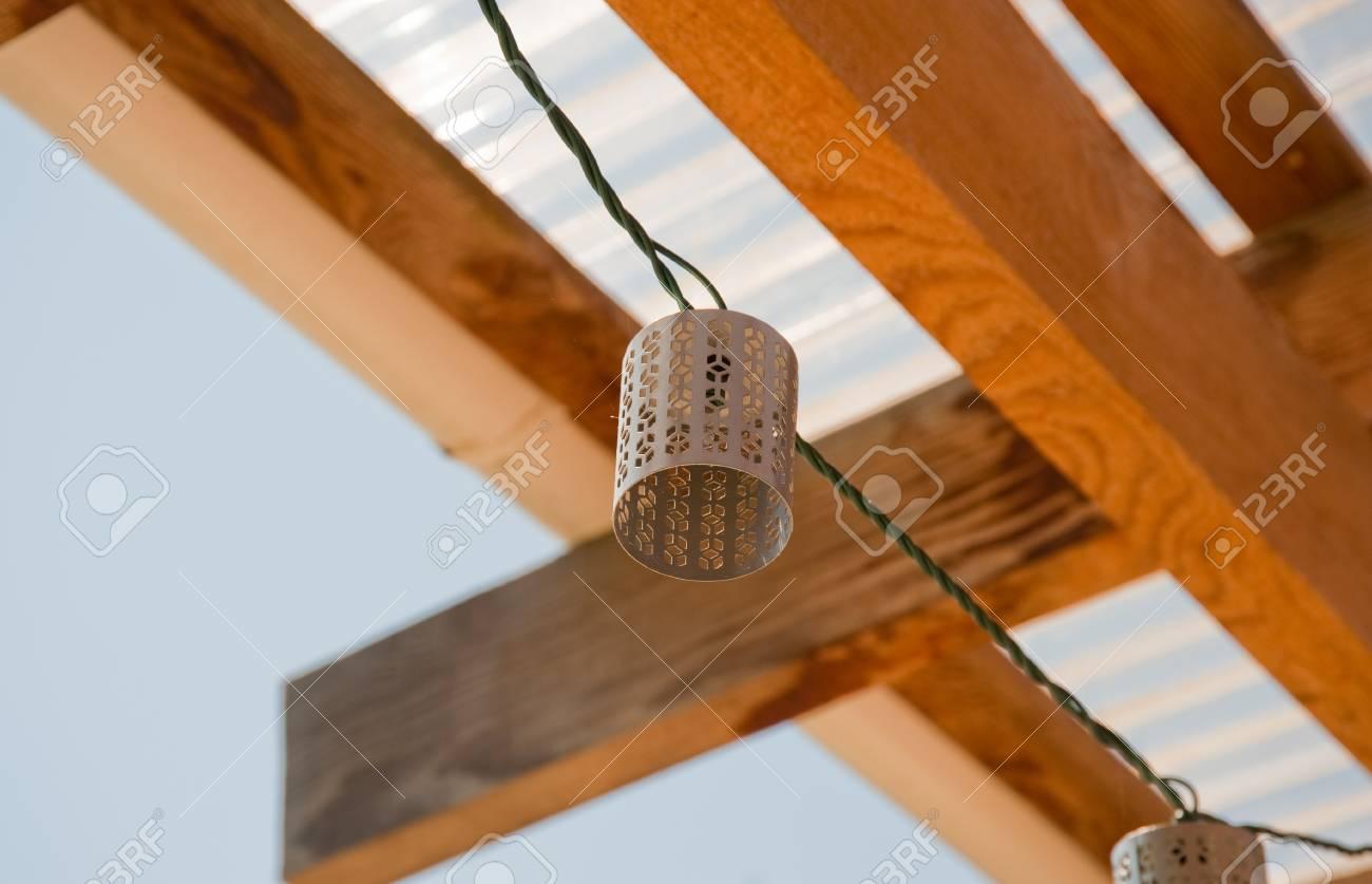 Decorative light shade and wooden beams - 106735719