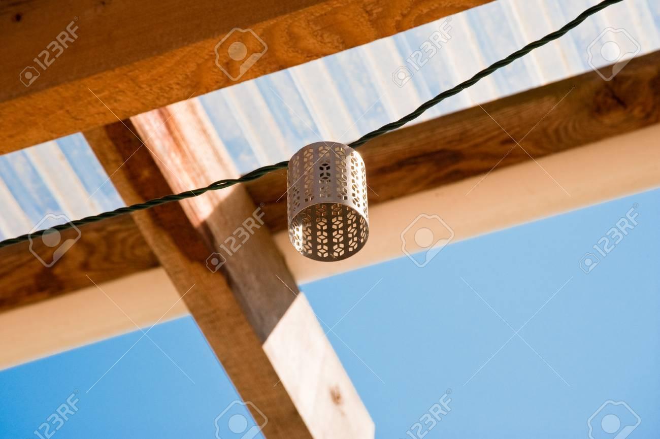 Decorative light shade and wooden beams - 106735723