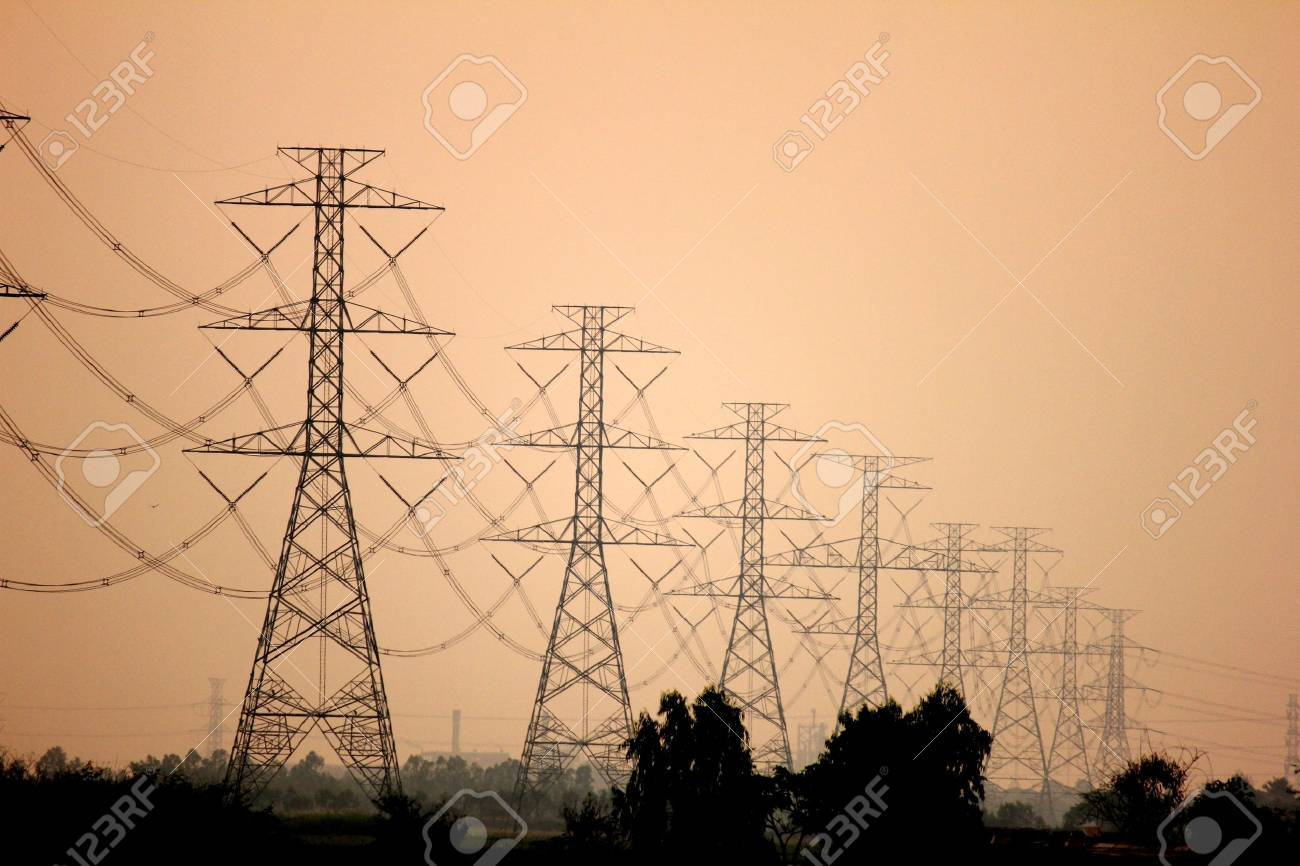 Electricity pylons and lines at sunset near Bangkok, Thailand Stock Photo - 14102660