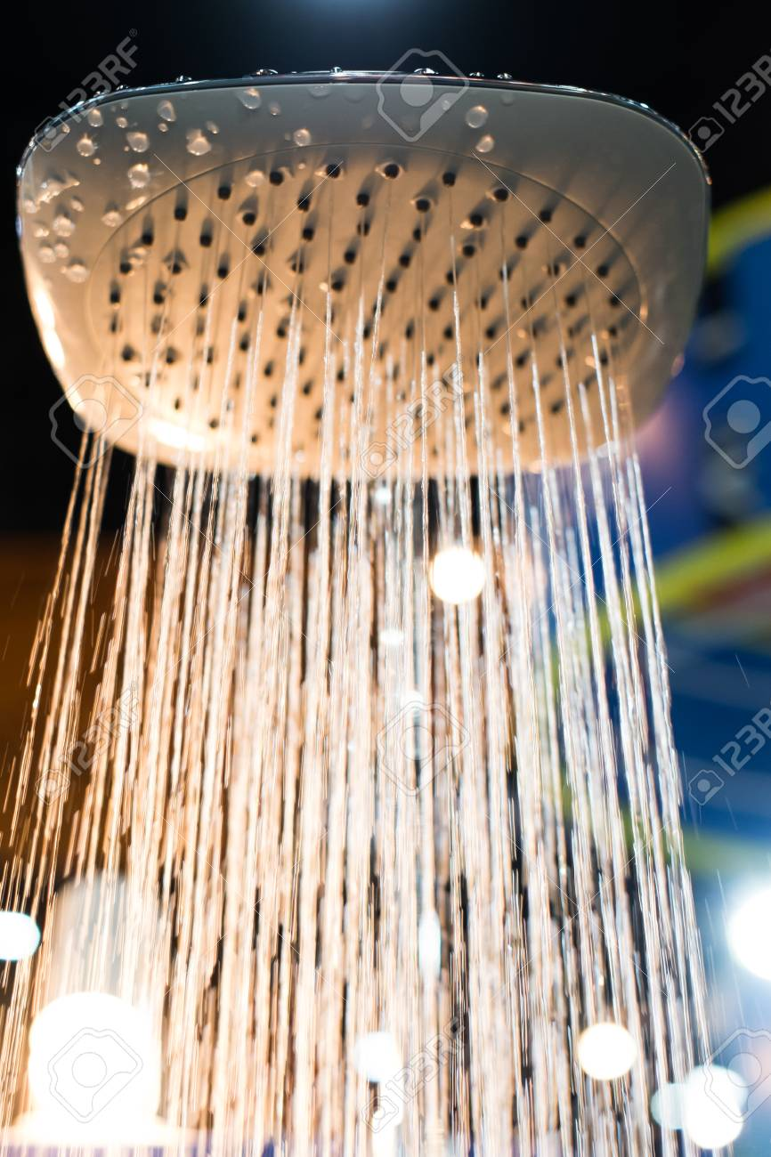 shower head water drops with sparkles and streams of water with light Stock Photo - 27042610