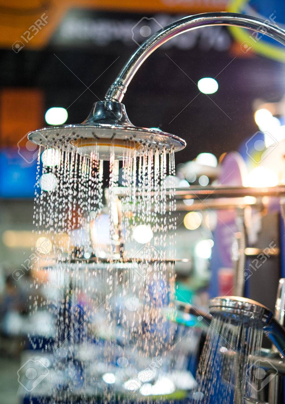 shower head water drops with sparkles and streams of water with light Stock Photo - 27042611