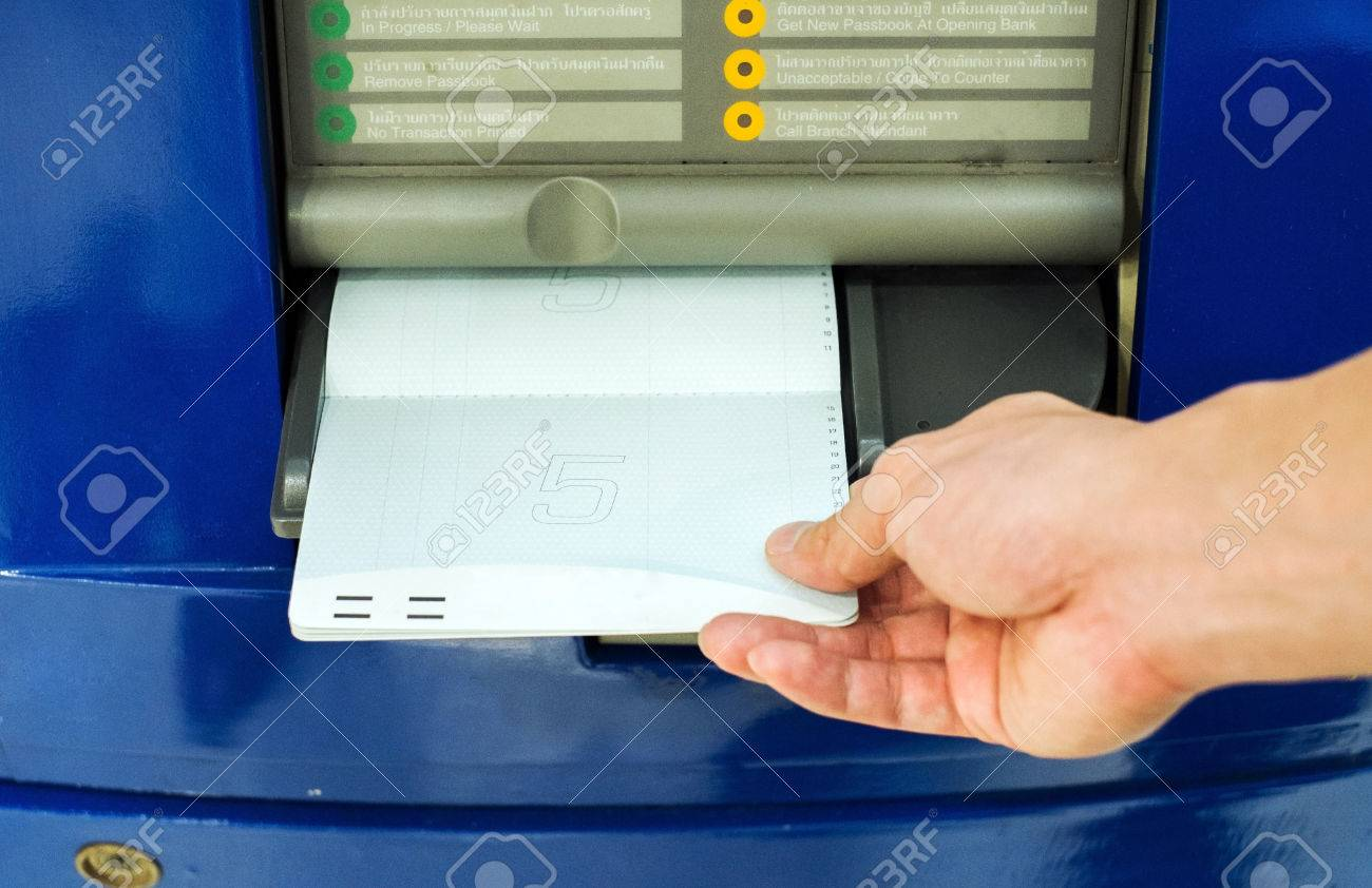 hand inserting account bankbook into automatic passbook update