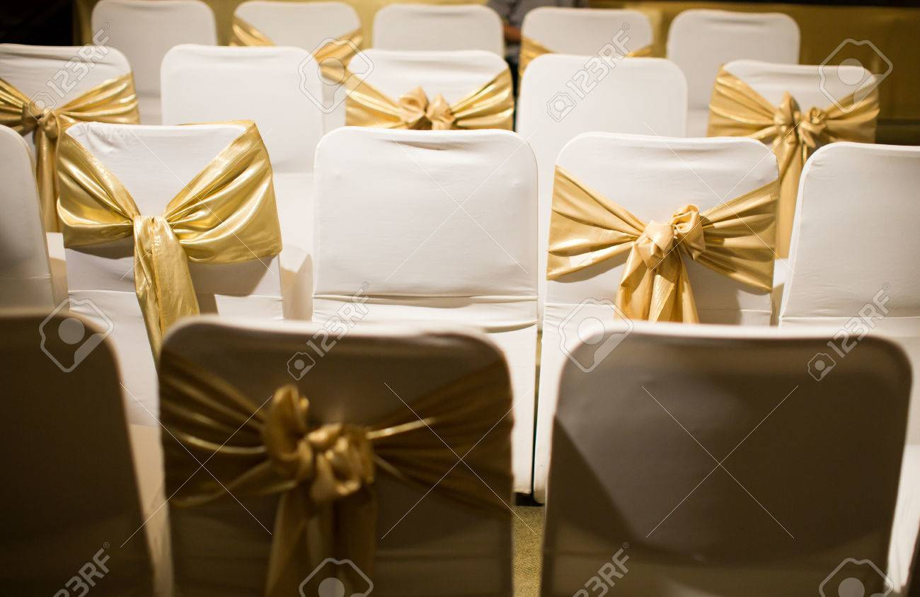 Wedding Chairs Decorated With Golden Ribbon In Warm Atmosphere Stock Photo    39232713