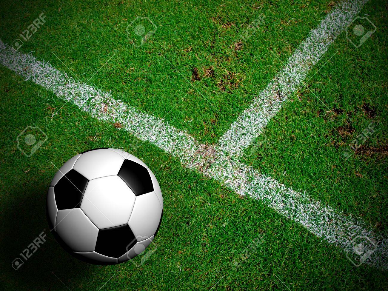 Football ( soccer ball ) in green grass field. Stock Photo - 14187628