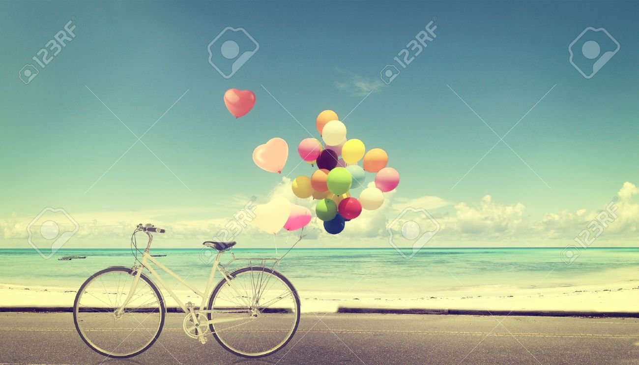 bicycle vintage with heart balloon on beach blue sky concept of love in summer and wedding Stock Photo - 33689820
