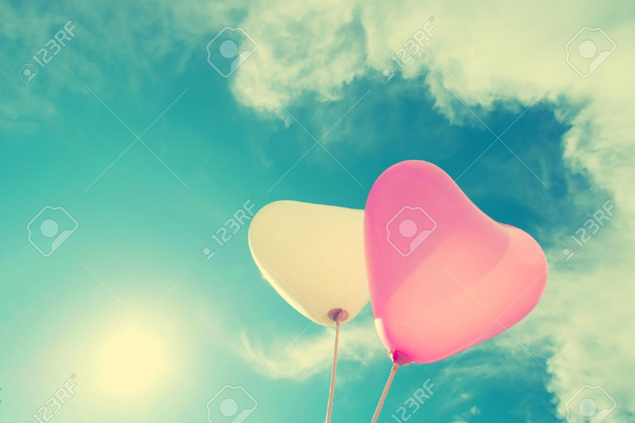 vintage heart balloon on blue sky concept of love in summer and valentine, wedding honeymoon Stock Photo - 47941839