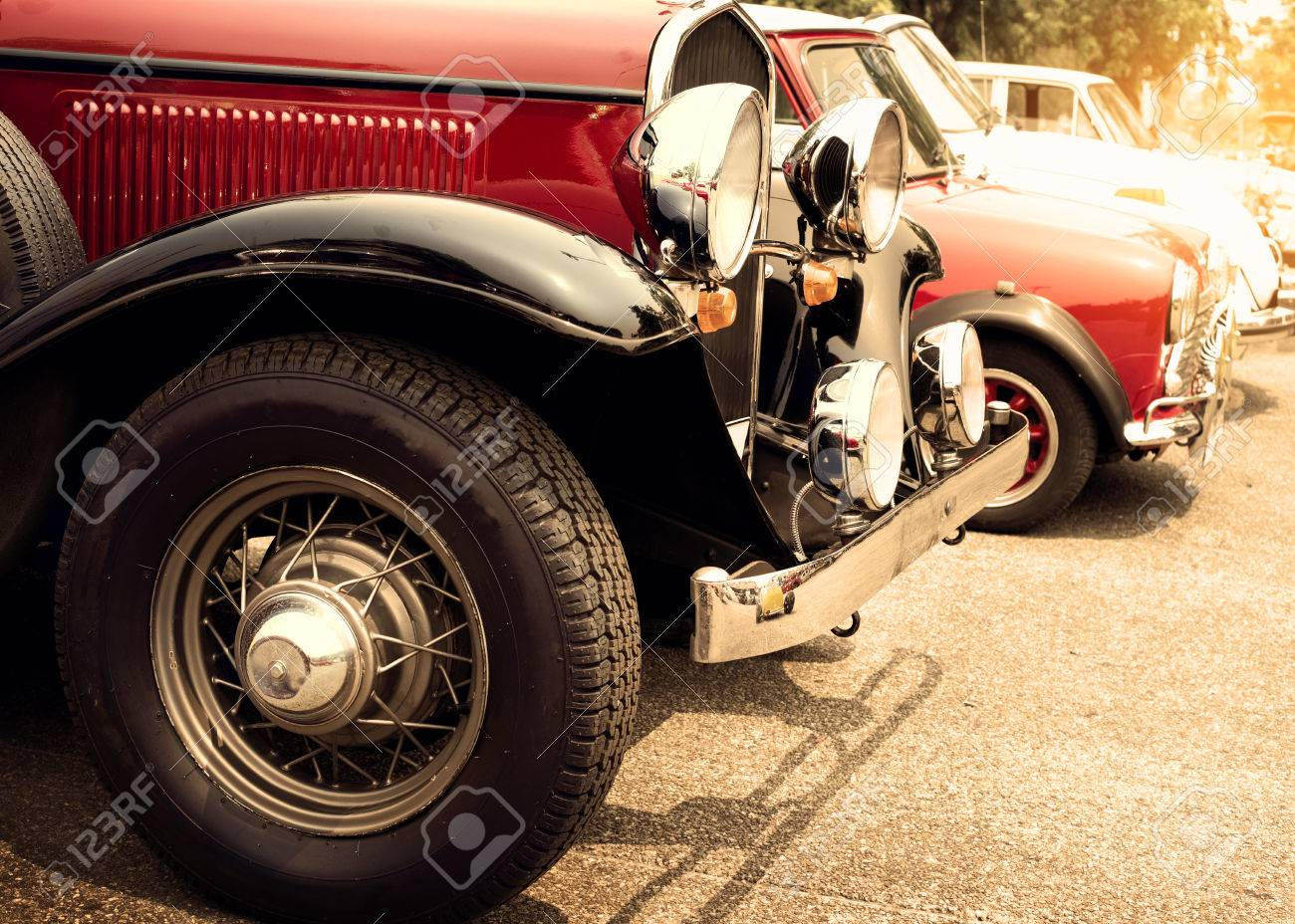 Detail of front vintage car wheels and headlight - Classic vehicles - 50568591