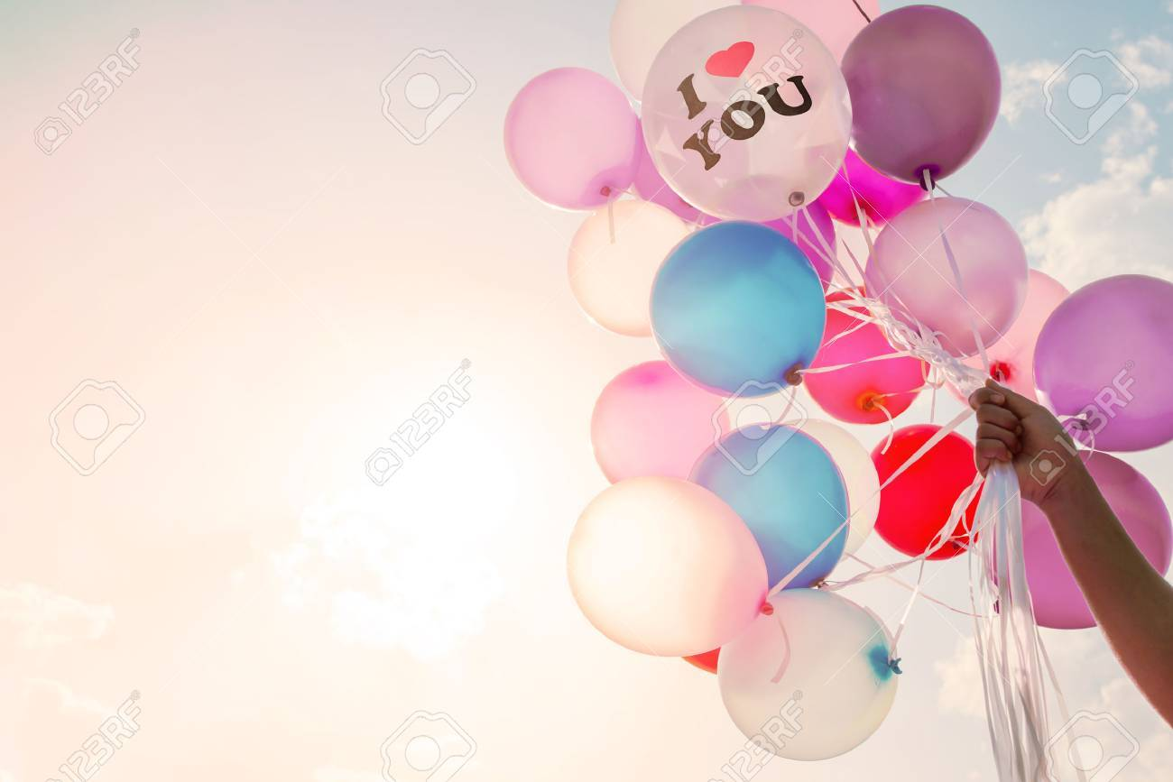 Woman hand holding balloon i love you symbol concept of love i love you symbol concept of love in valentine day biocorpaavc Gallery