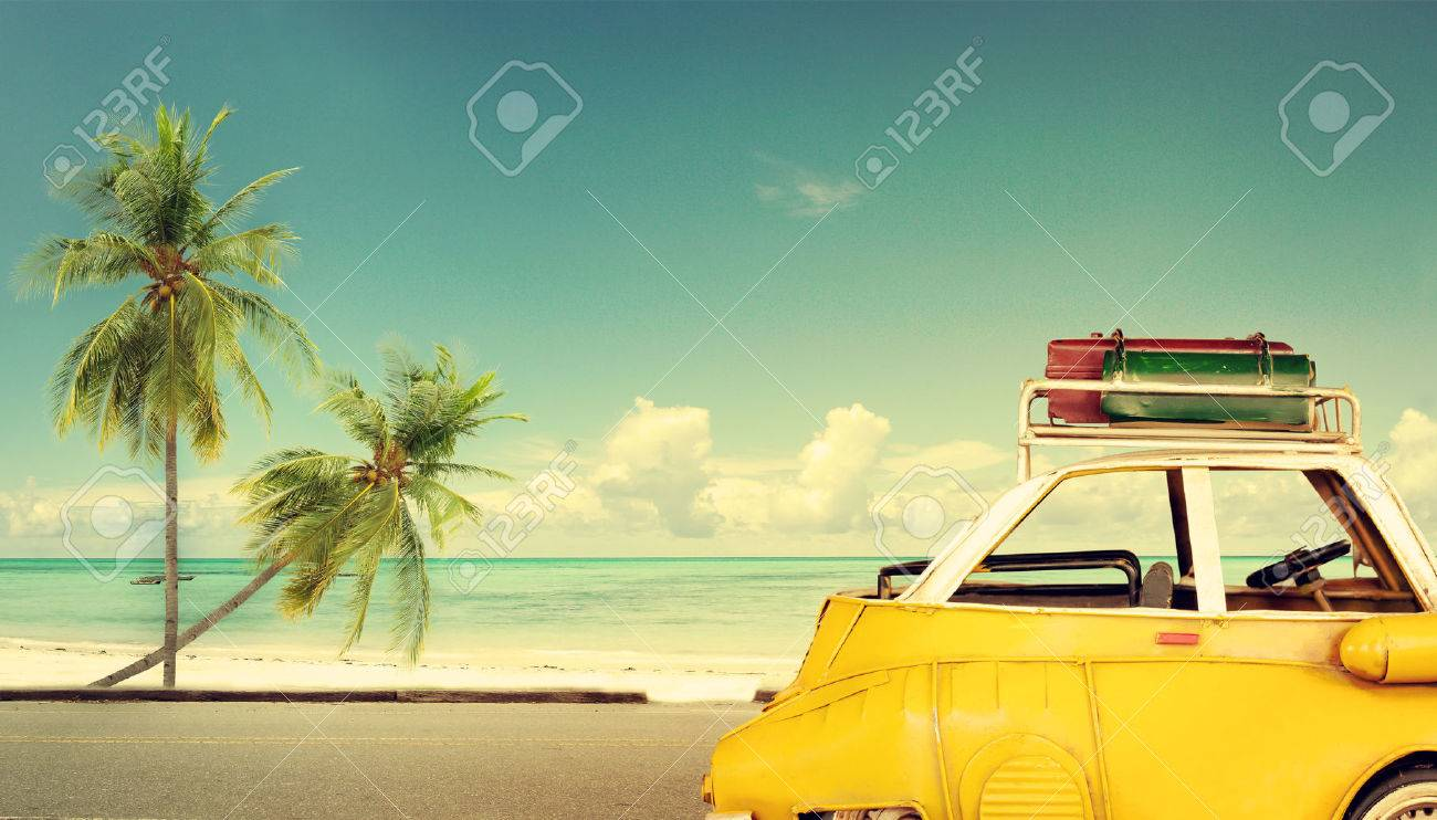 Travel destination: vintage classic car parked near the beach with bags on a roof - Honeymoon trip in summer - 50571703