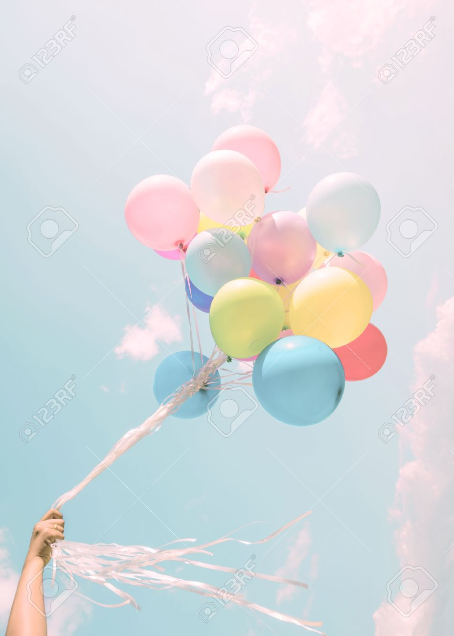Girl Hand Holding Colorful Balloons Happy Birthday Party Vintage Pastel Filter Effect Stock Photo