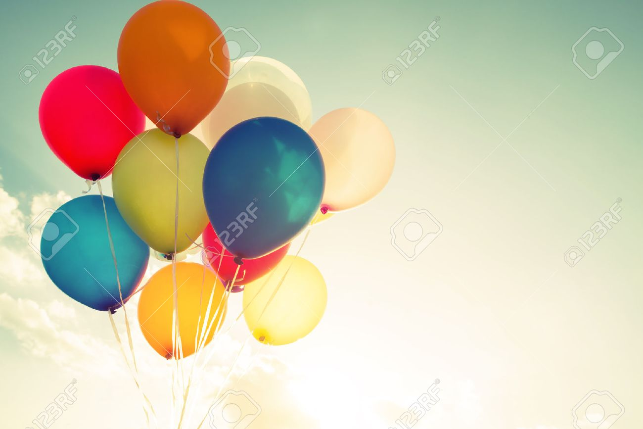 multicolor balloons with a retro filter effect, concept of happy birthday in summer and wedding honeymoon party (Vintage color tone) - 52070594