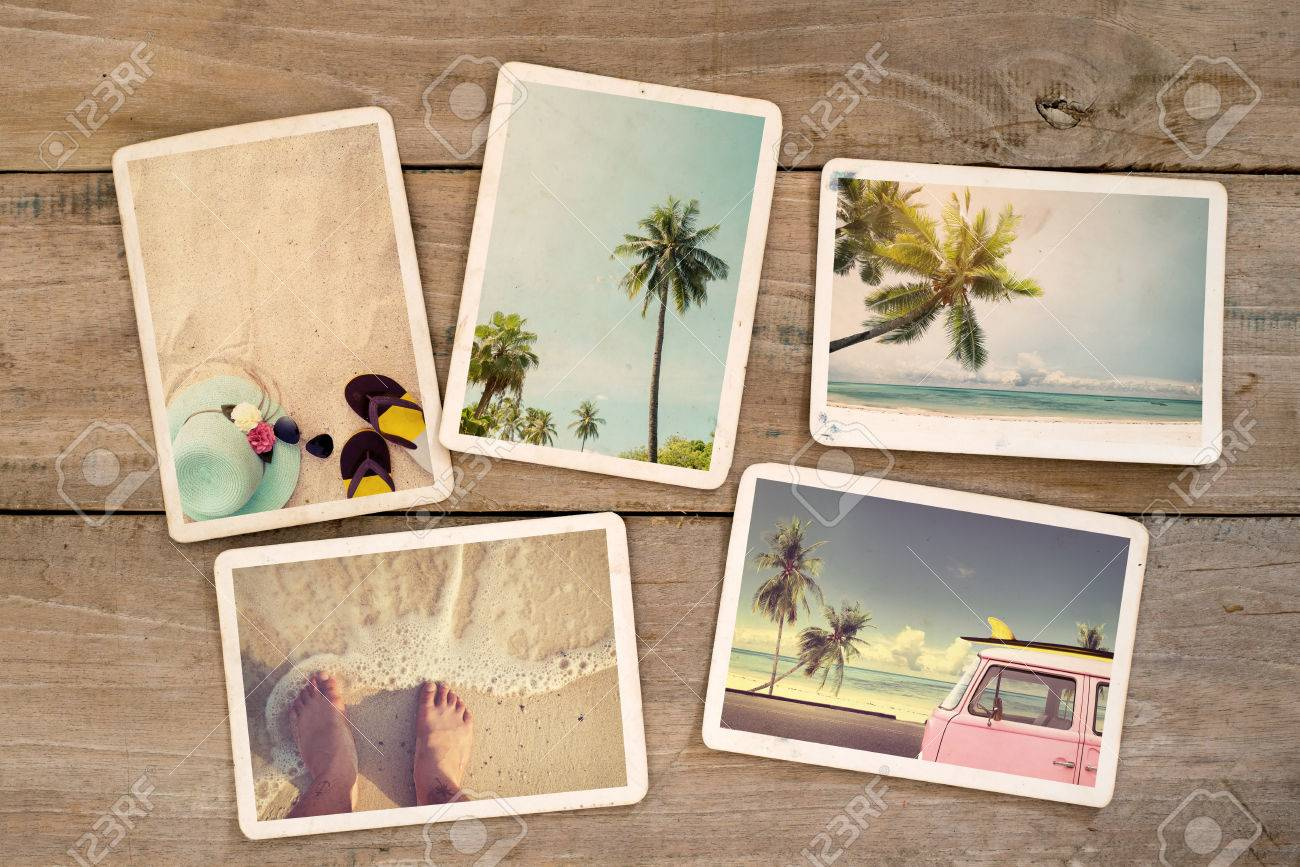 Photo album remembrance and nostalgia journey in summer surfing beach trip on wood table. instant photo of vintage camera - vintage and retro style - 58868808