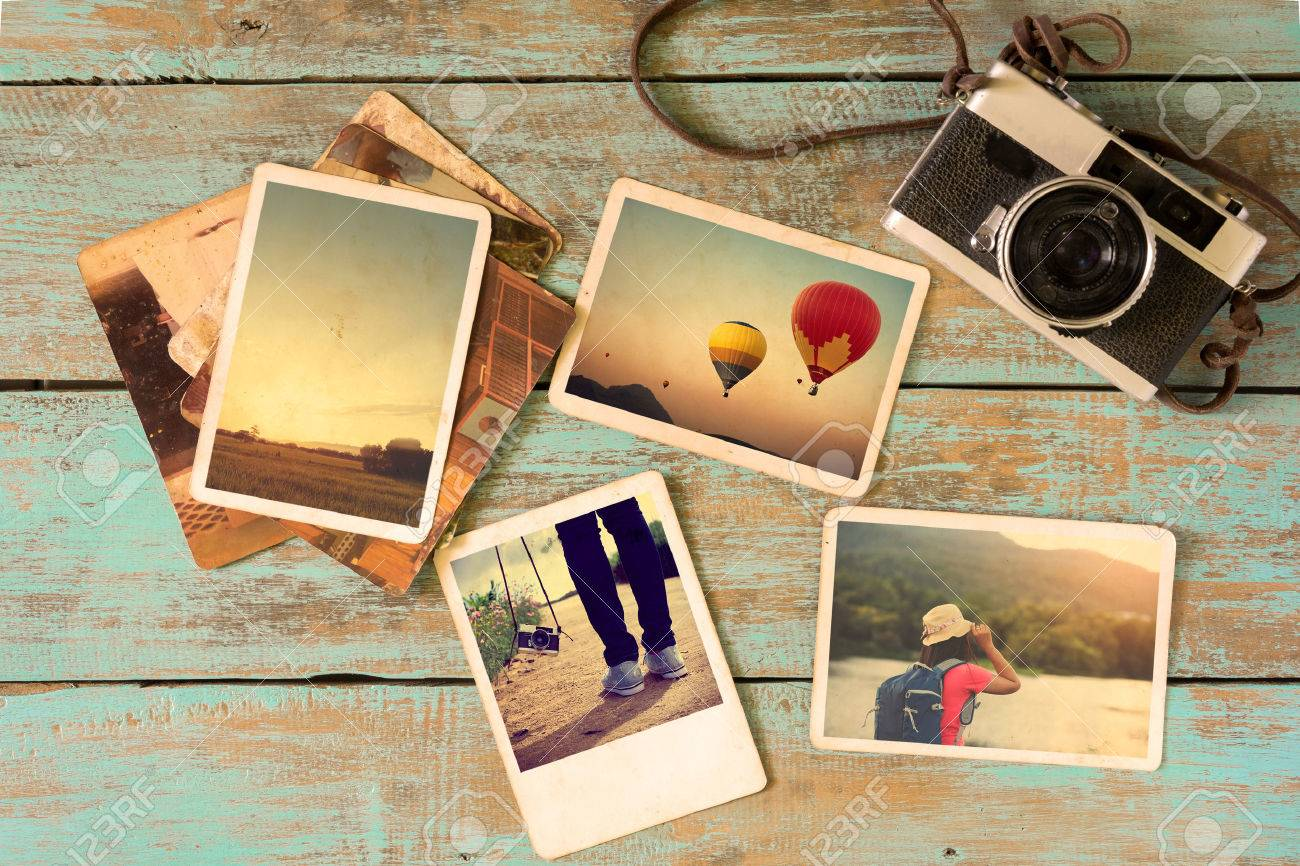 Photo album remembrance and nostalgia in summer journey trip on wood table. instant photo of vintage camera - vintage and retro style - 60643682