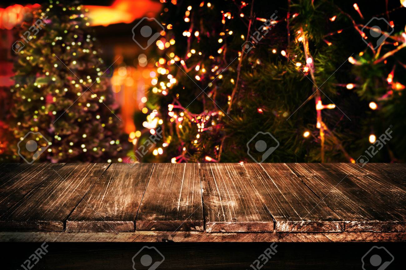Christmas and new year background with empty dark wooden deck christmas and new year background with empty dark wooden deck table over christmas tree and blurred aloadofball Gallery