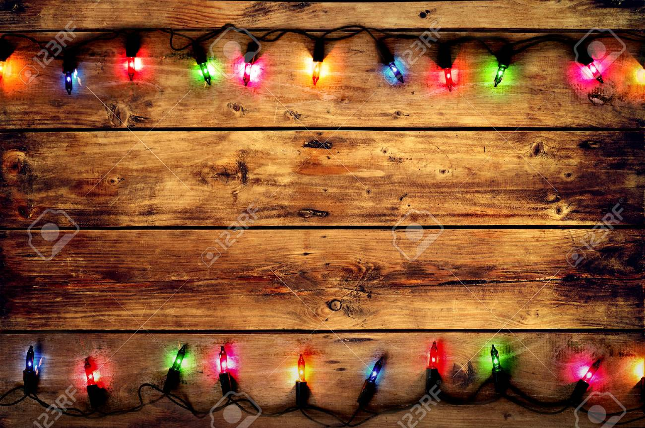 christmas and new year rustic background vintage planked dark wood with lights and free text