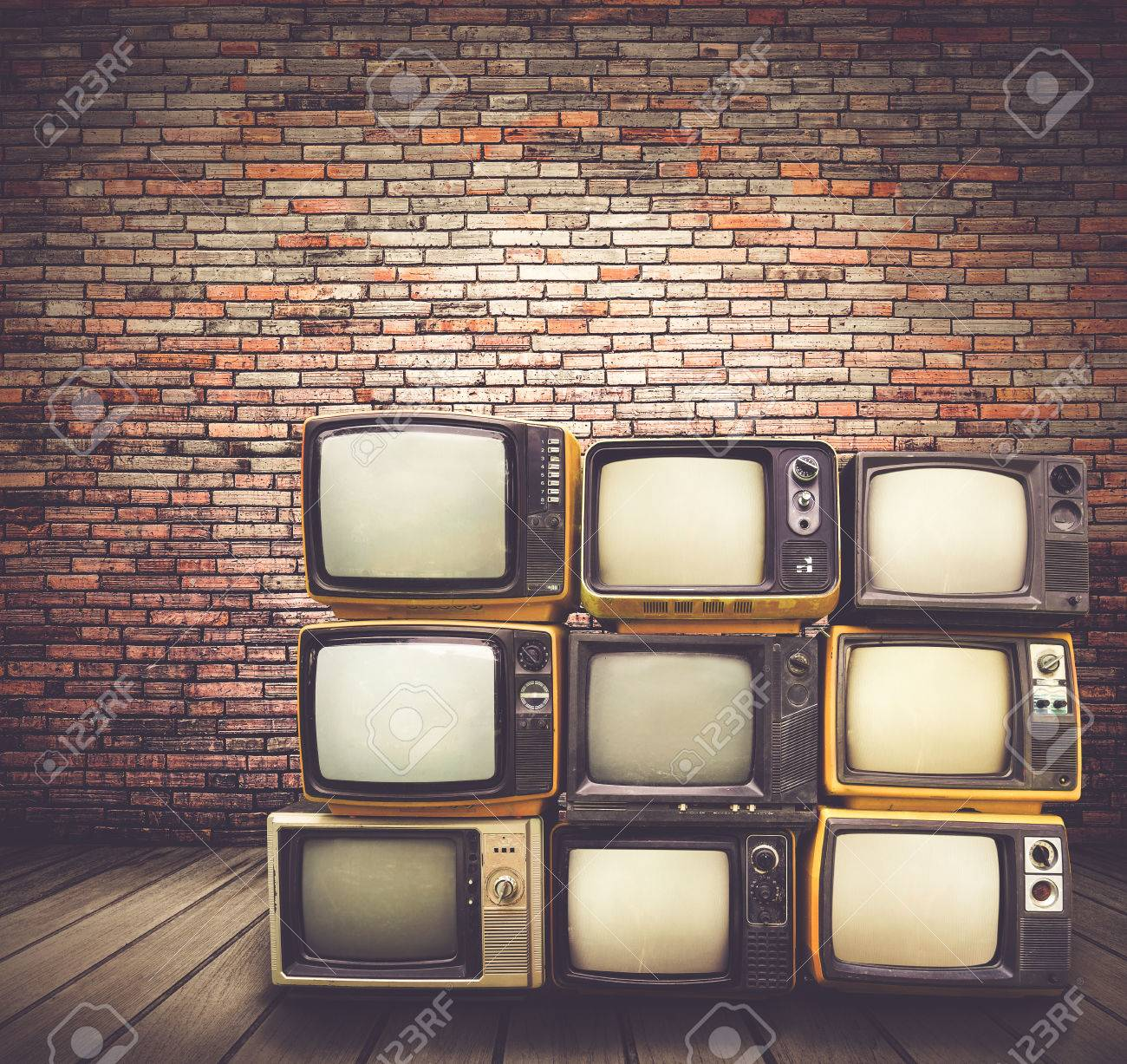 antique and vintage style photo retro televisions pile on floor