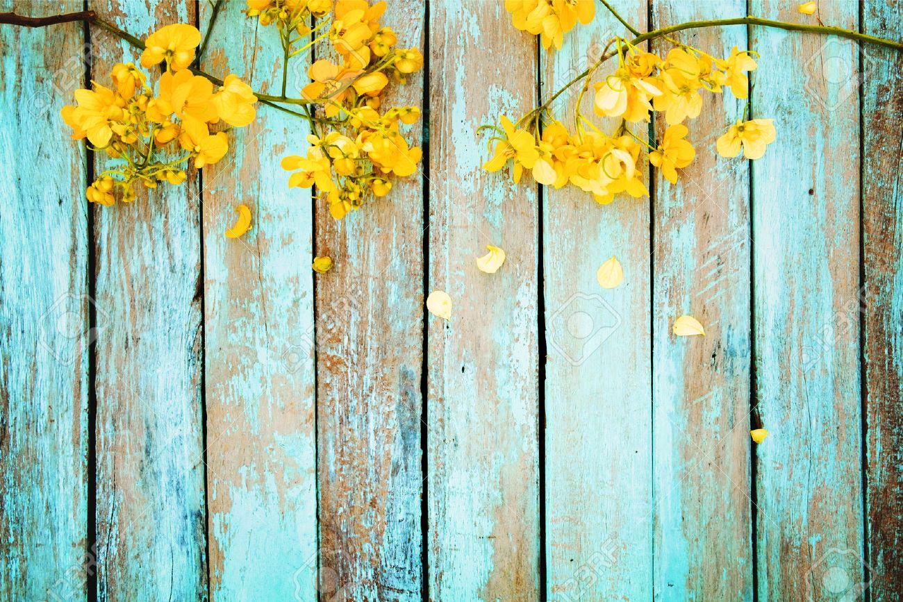 Yellow flowers on vintage wooden background, border design. vintage color tone - concept flower of spring or summer background - 68874528