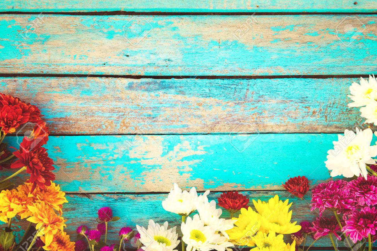 Colorful flowers bouquet on vintage wooden background, border design. vintage color tone - concept flower of spring or summer background - 68876276