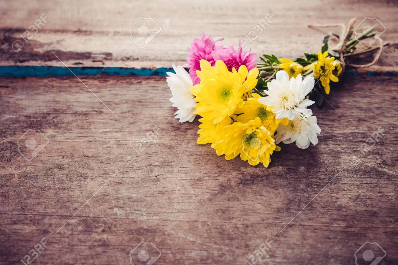 Bouquet flowers in spring on vintage wooden background vintage bouquet flowers in spring on vintage wooden background vintage color tone stock photo izmirmasajfo