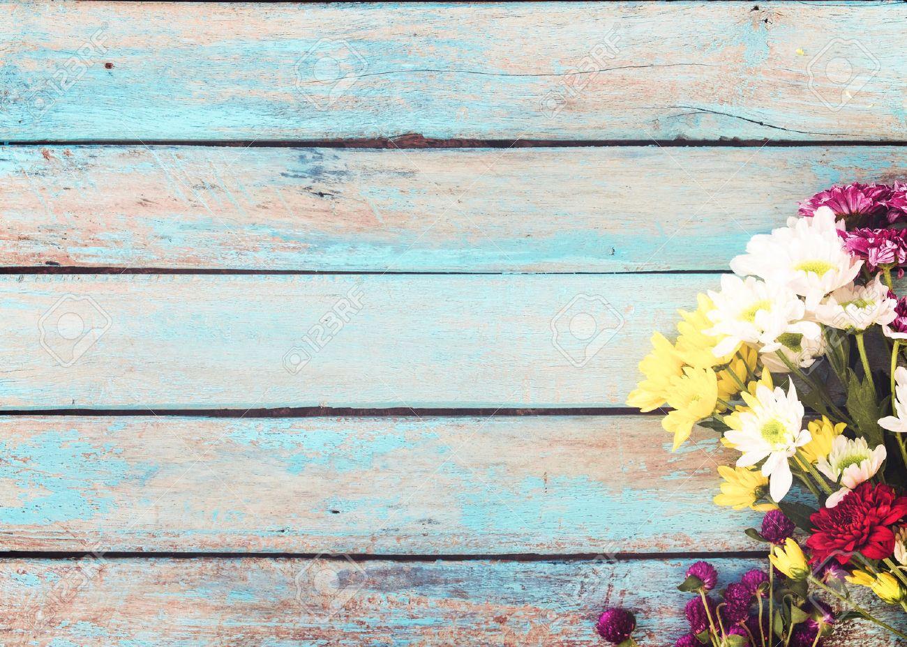 Colorful flowers bouquet on vintage wooden background, border design. vintage color tone - concept flower of spring or summer background - 71988586