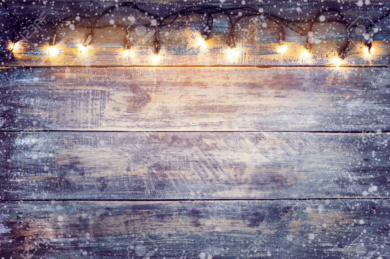 Christmas Lights Bulb With Snow On Wood Table Merry Xmas Background