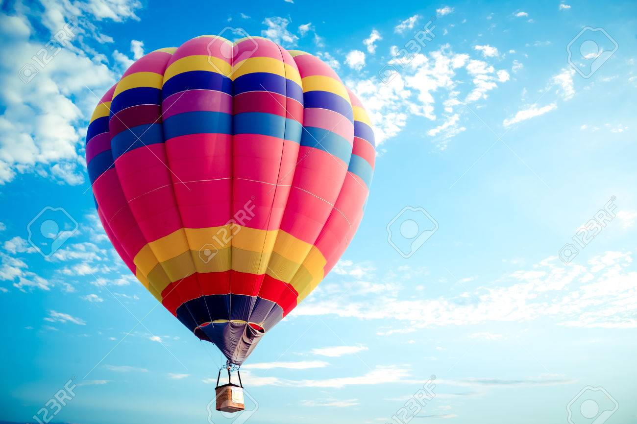 Colorful hot air balloon flying on sky  travel and air transportation